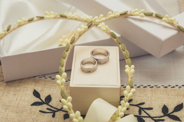 wedding rings with traditional wedding crowns stock photo