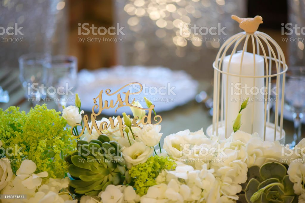 Wedding romantic decor for bride and groom dinner table with white...