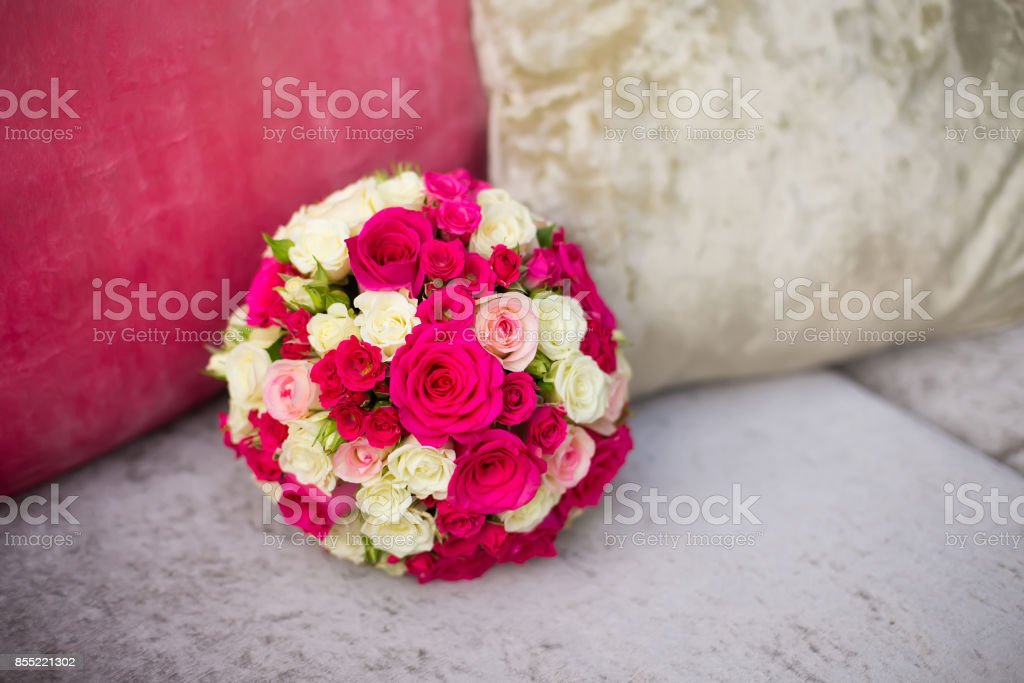 wedding saturate pink rose bouquet of bride on sofa stock photo