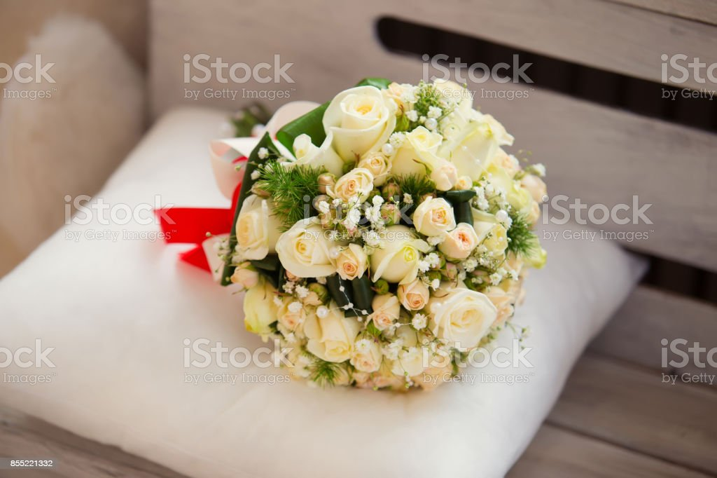 wedding saturate rose bouquet of bride on wooden background stock photo