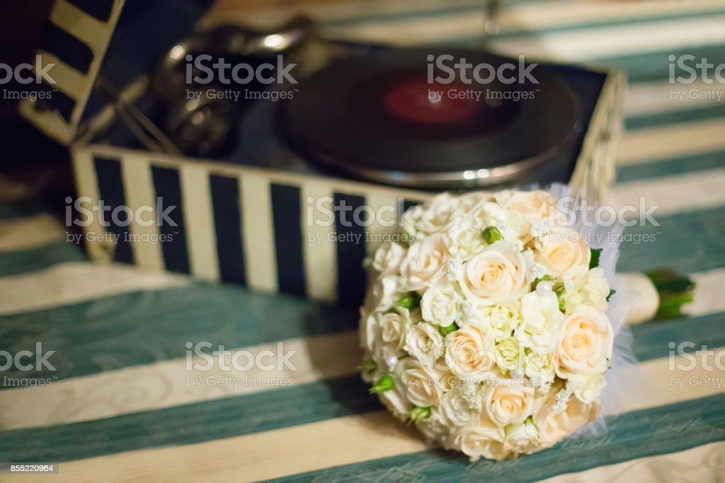 wedding saturate white rose bouquet of bride on table stock photo