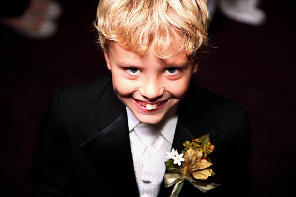 wedding scene - ring bearer boy stock photo