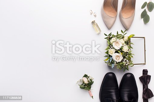 Bridal room. Wedding shoes and accessories on white background with copy space for text