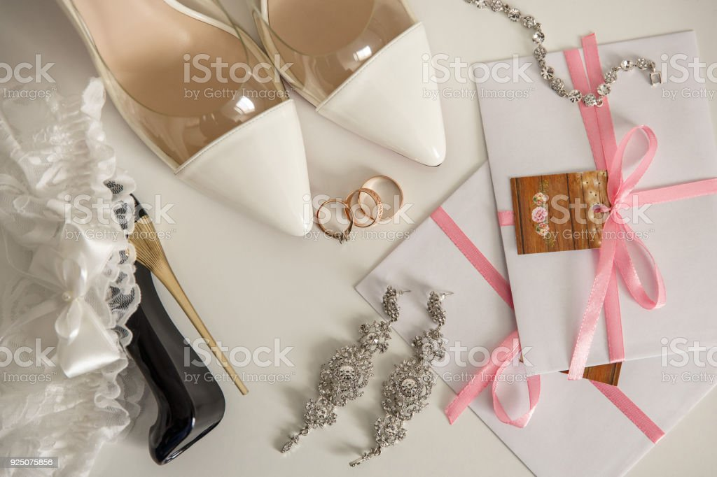 Wedding Shoes For Bride Near One Engagement Ring And Two Wedding