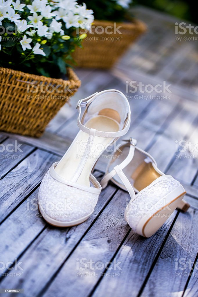 Wedding shoes on patio royalty-free stock photo