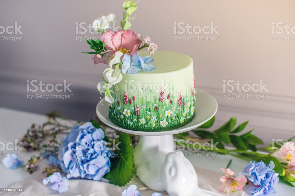 Wedding spring cake decorated with colorful flowers and hydrangeas. Desserts for a festive summer mood stock photo