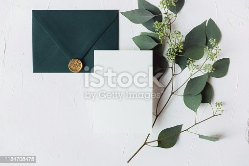 A beautiful styled wedding stationery card & envelope with silk ribbon & silk flowers mockup.