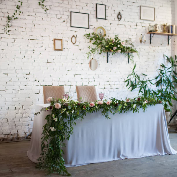 Wedding table decorated with flowers stock photo