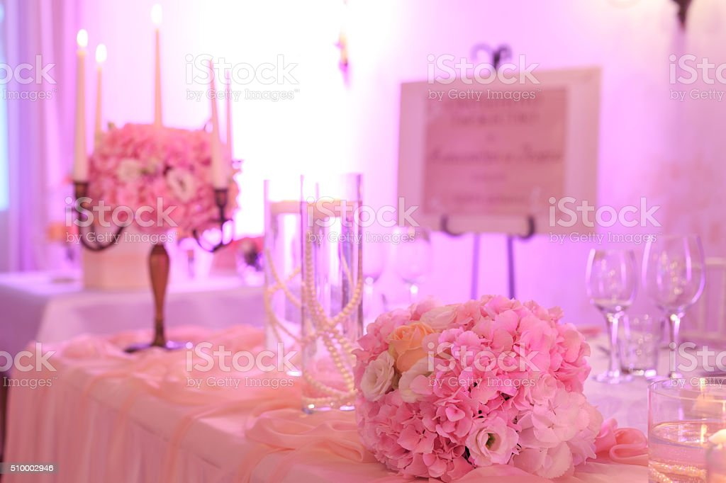 Wedding table decoration with flowers and wineglasses stock photo