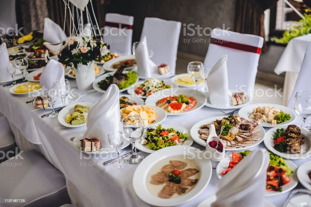 Wedding table, food, drinks, water. Table with silver and glass...