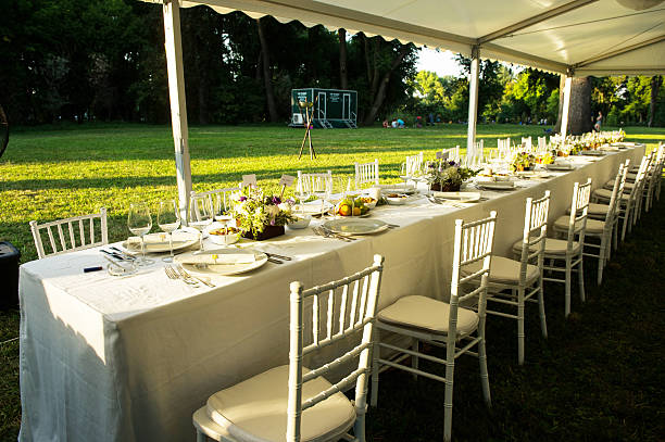 Wedding table Luxury wedding lunch table setting outdoors entertainment tent stock pictures, royalty-free photos & images