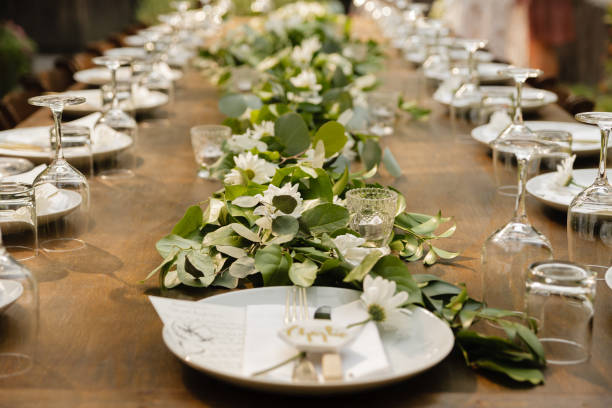 wedding table setting on a long wood table - entertainment building stock pictures, royalty-free photos & images