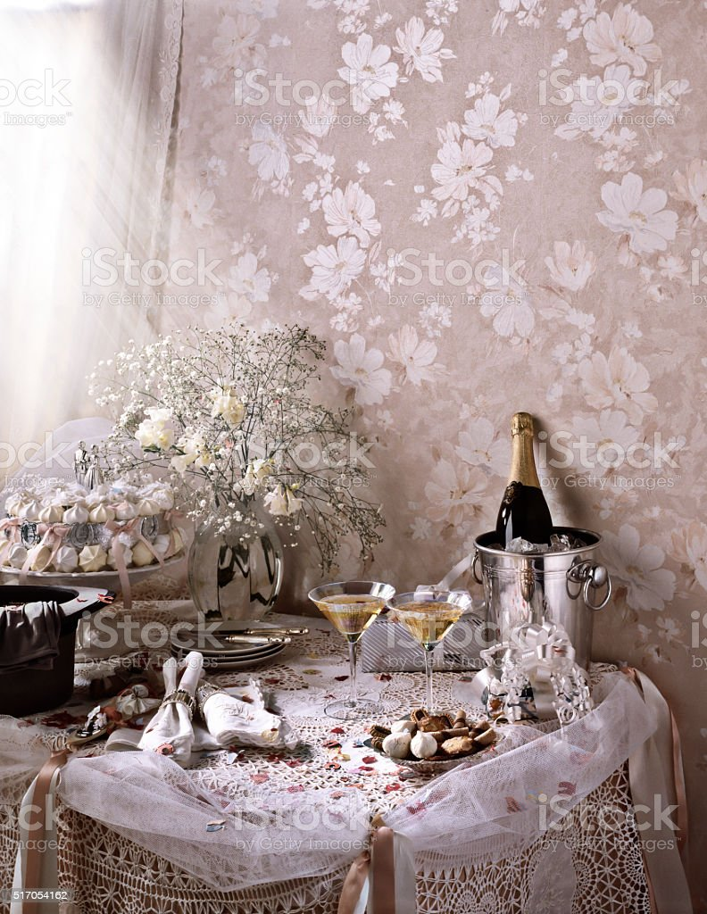 Wedding Table Themed with Champagne, Top Hat, Flowers stock photo