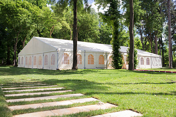 wedding tent wedding tent on a grassy meaddow in a forrest entertainment tent stock pictures, royalty-free photos & images