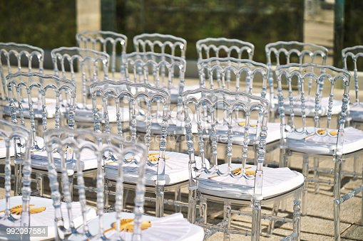 istock Wedding venue setup, the ghost chairs is trendy and popular use for beach wedding 992097584