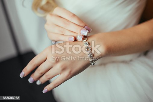 Wedding. Wedding day. Luxury bracelet on the bride's hand close-up Hands of the bride before wedding. Wedding accessories.