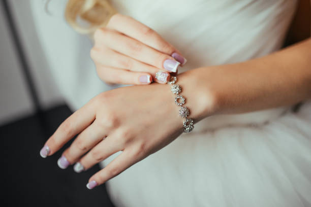 Wedding. Wedding day. Luxury bracelet on the bride's hand close-up Hands of the bride before wedding. Wedding accessories. Selective focus. stock photo