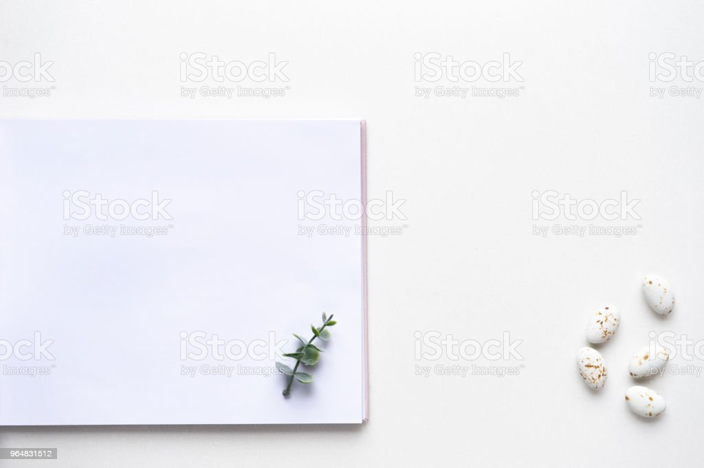 Wedding wish book, candy and oregano branches on white marble. Top view royalty-free stock photo