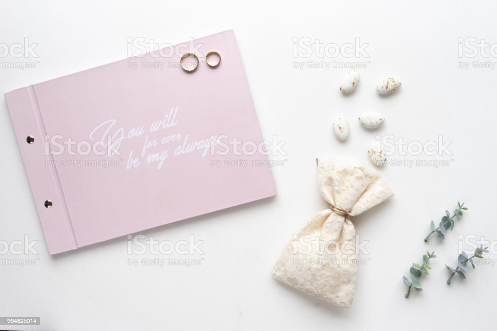 Wedding wish book, cany, weddings rings and oregano branches. Top view. royalty-free stock photo