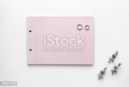 Wedding Wish Book On White Marble With Weddings Rings And Oregano Branches Top View Stock Photo & More Pictures of Blank