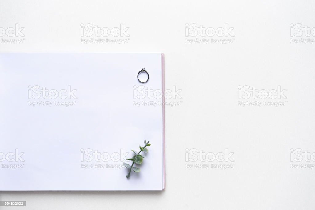 Wedding wish card on white marble with weddings rings and oregano branches. Top view. royalty-free stock photo