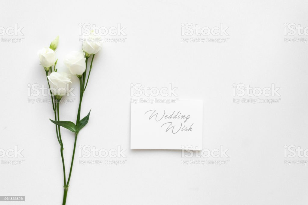 Wedding wish card with roses, on white marble. Top view. royalty-free stock photo