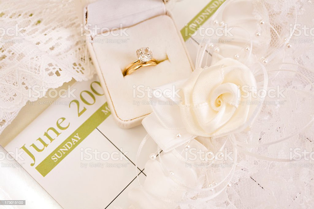 Weddings:  Calendar showing month of June with wedding ring set royalty-free stock photo