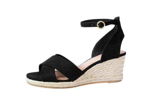 f94d1409371 Wedge heeled shoe stock photo · Black Fancy Wedge Sandals on White ...