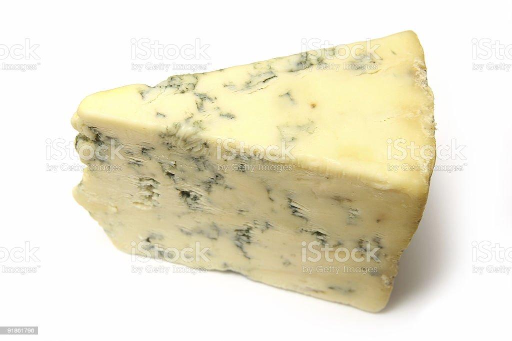 Wedge of Stilton Cheese on a white studio background. royalty-free stock photo