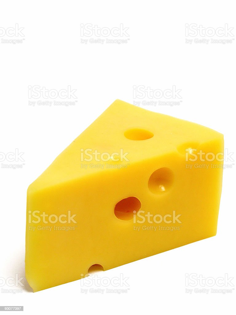 Wedge of Swiss cheese on white background stock photo