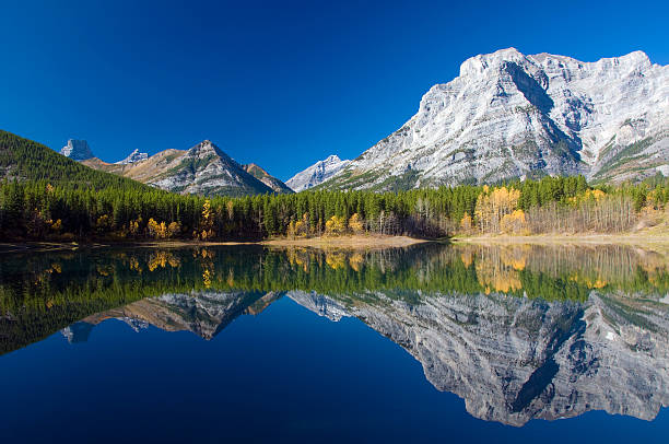 Wedge Pond, Kananaskis, Alberta Wedge Pond is in Kananaskis Country, Alberta, just east of Banff in the Rocky Mountains. Taken in the fall in the early morning. kananaskis country stock pictures, royalty-free photos & images