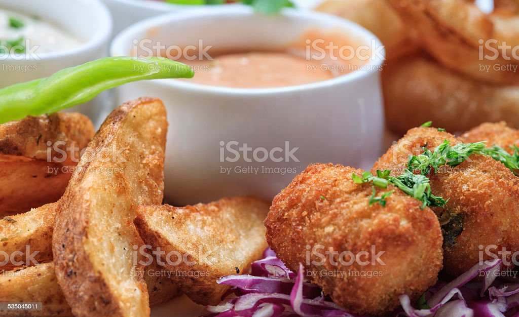 Wedges and cheese balls stock photo