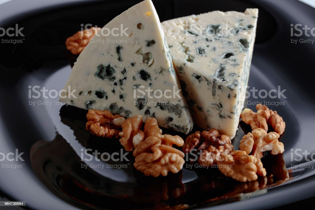 Wedges of soft blue cheese with walnuts. royalty-free stock photo