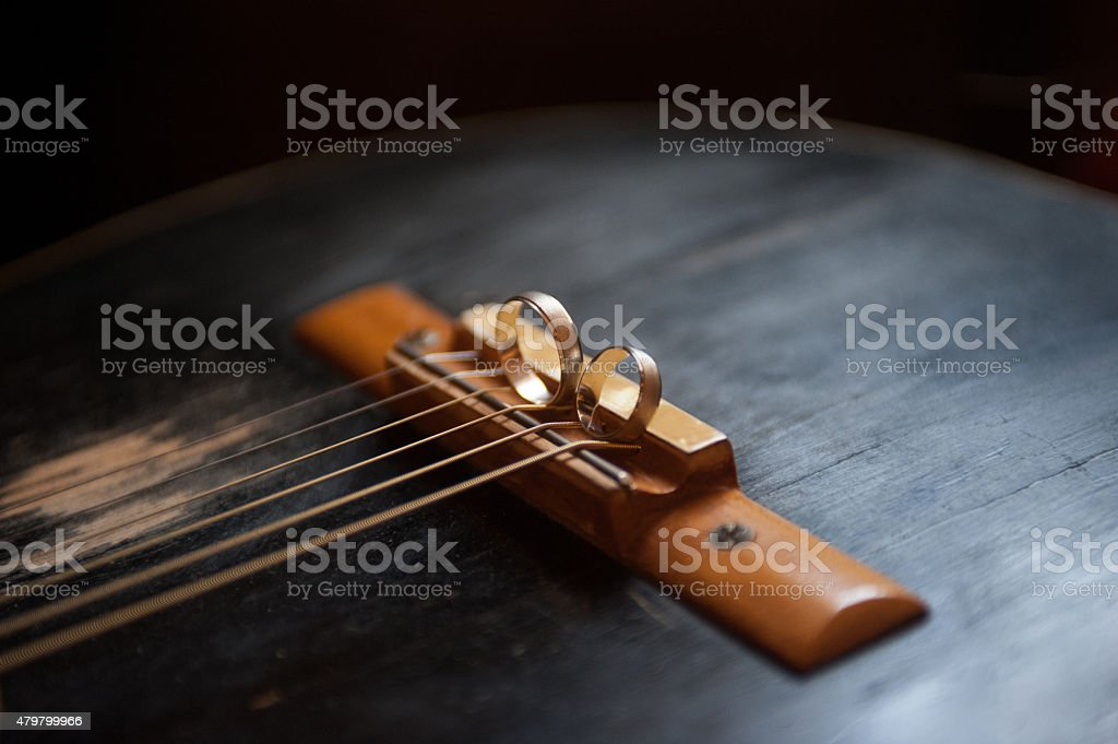 Weeding rings on the old guitar stock photo