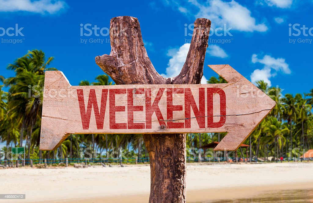 Weekend arrow with beach background stock photo