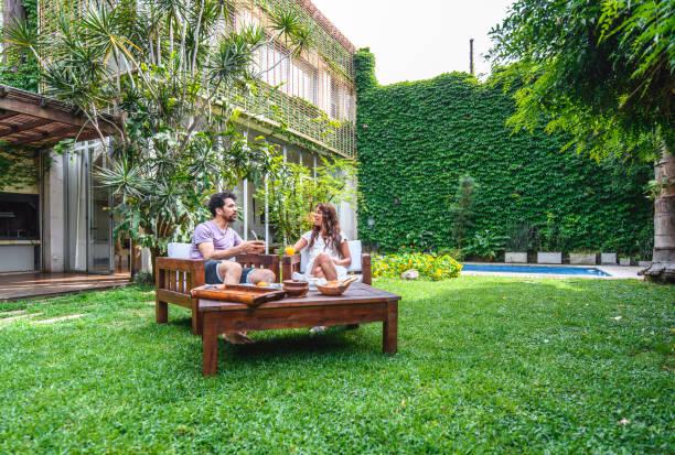 Weekend Breakfast and Conversation in Backyard stock photo