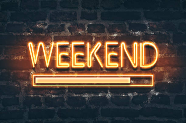 Weekend loading Weekend loading neon sign on dark brick wall background sunday stock pictures, royalty-free photos & images