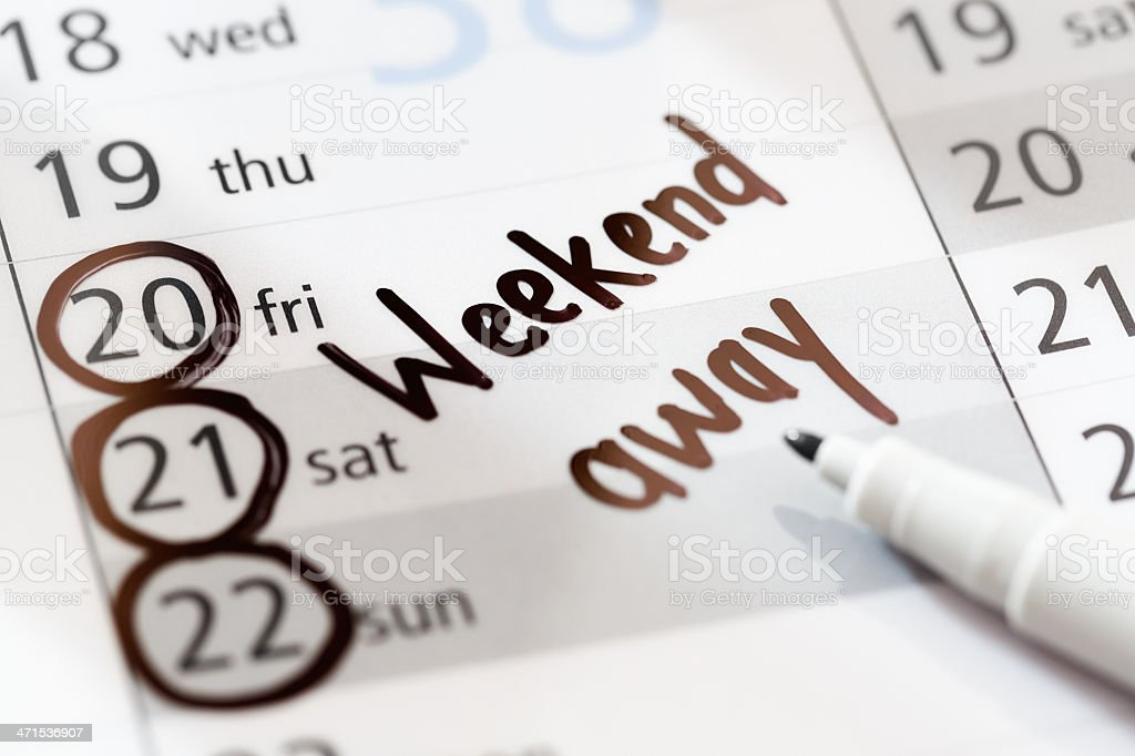 Weekend vacation away marked on non-specific calendar stock photo