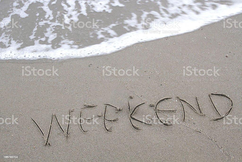 Weekend write on beach. stock photo