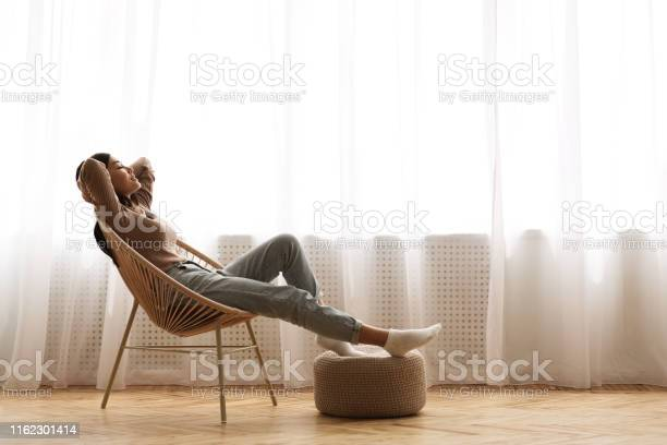 Weekends finally relaxed girl sitting on modern chair picture id1162301414?b=1&k=6&m=1162301414&s=612x612&h=38tdfn6orh3a 3l8rgtve248yirlpb4l1au x63k824=