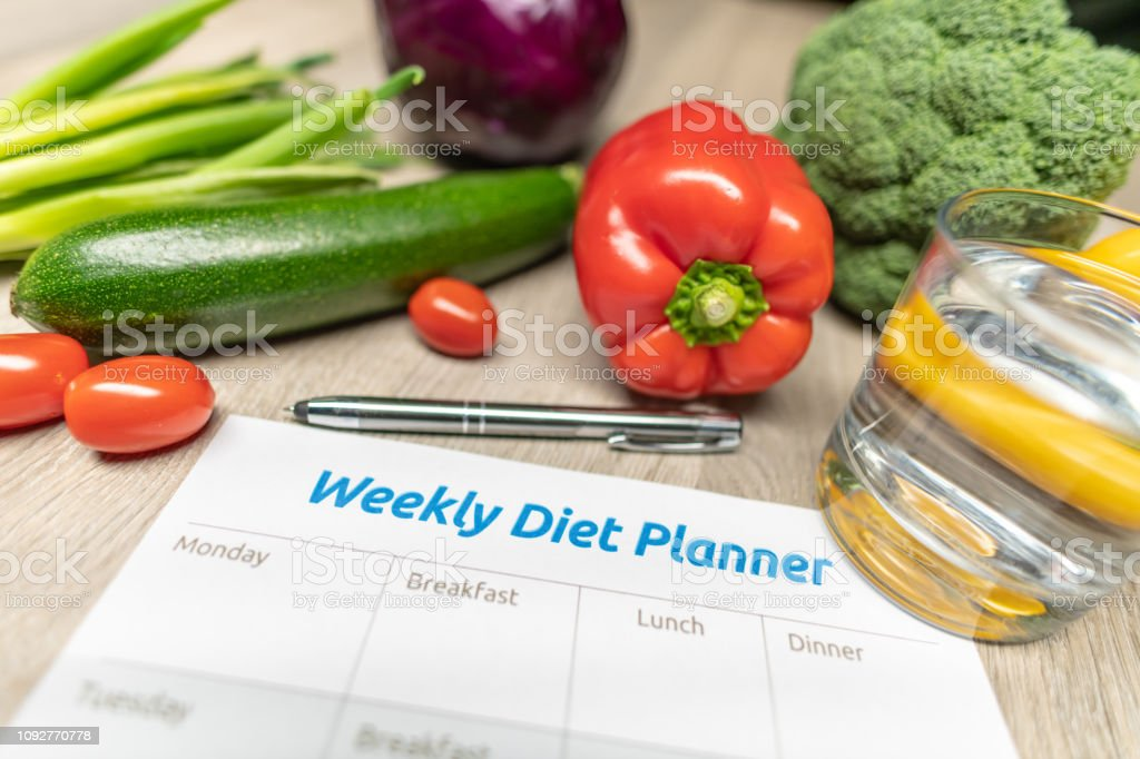 Weekly Diet Planner with lots of healthy vegetables royalty-free stock photo