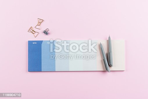 istock Weekly planner or calendar on the pink background. School week planning. Back to school, student, college, university concept 1156904710