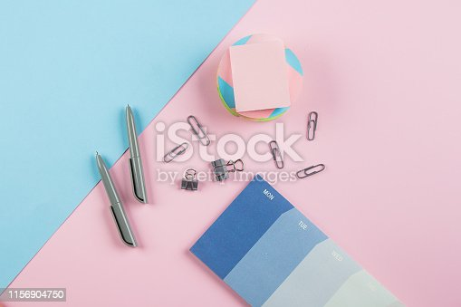 istock Weekly planner or calendar on the pink background. School week planning. Back to school, student, college, university concept 1156904750
