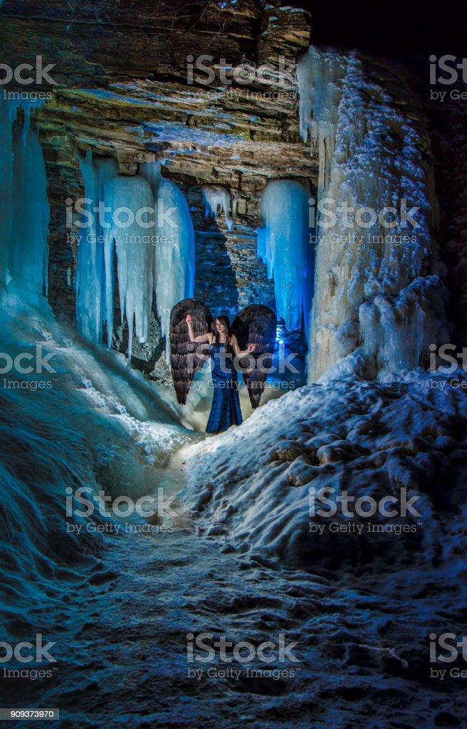 Weeping Angel in a frozen waterfall stock photo