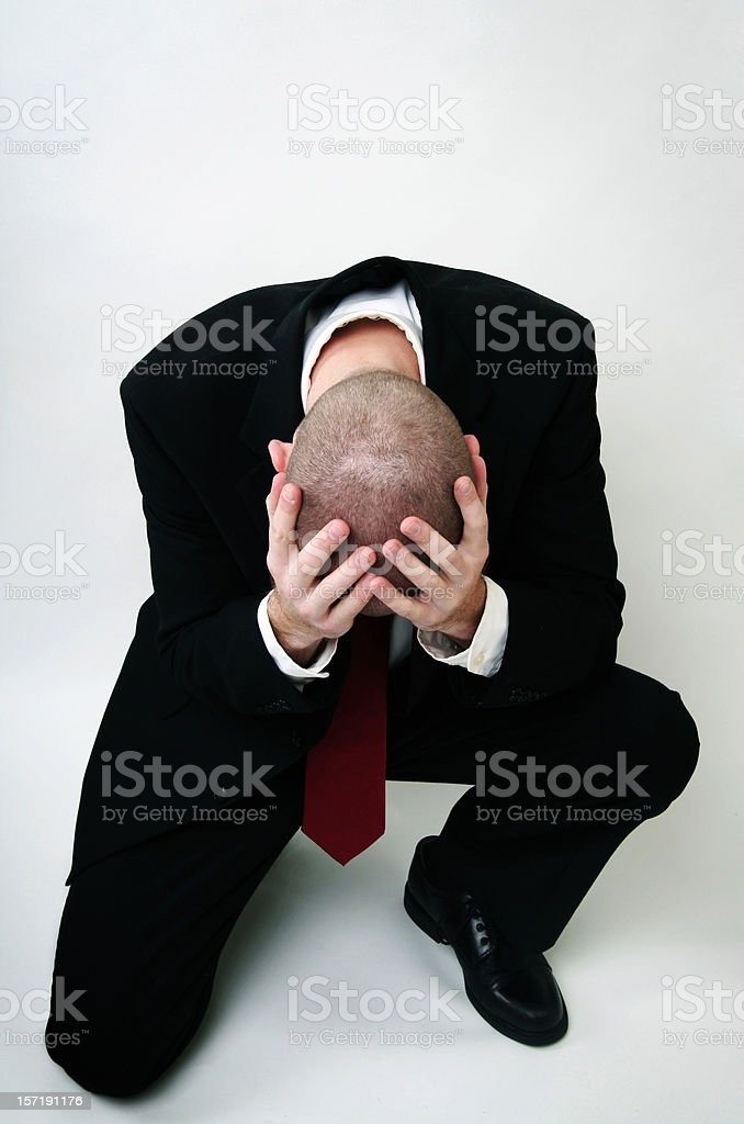 Weeping Grieving Young Business Man royalty-free stock photo