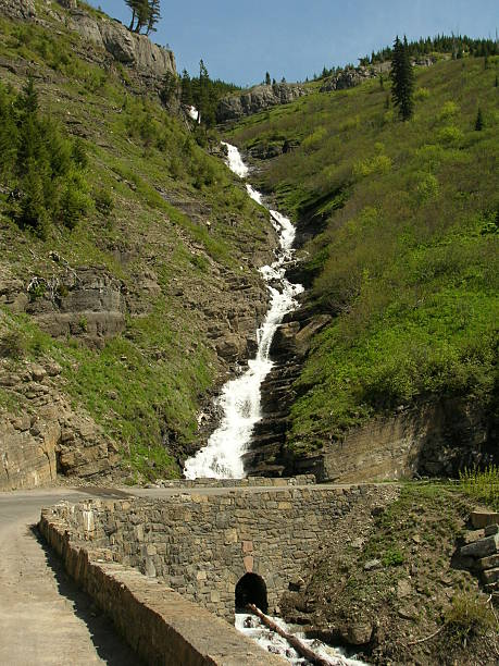 weeping wall waterfall - going to the sun road stock pictures, royalty-free photos & images