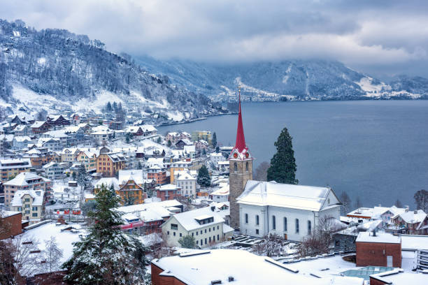 weggis village on lake lucerne, swiss alps mountains, switzerland, in winter time - lucerne stock pictures, royalty-free photos & images
