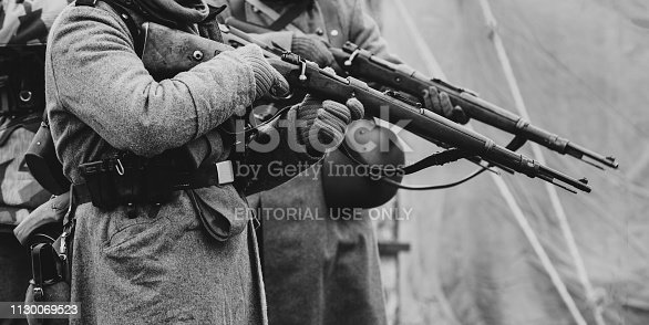 1061204700 istock photo Wehrmacht soldiers are preparing to shoot out Mauser rifles 1130069523