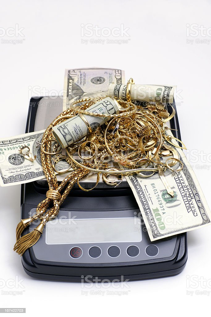 Weigh your gold for cash royalty-free stock photo