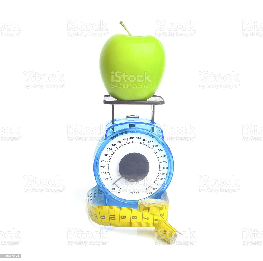 Weighing an apple royalty-free stock photo